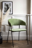 Lifestyle image image front on at an angle of the Curved Back Velvet Dining Chair In Moss Green