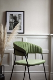 Lifestyle image from the side of the Curved Back Velvet Dining Chair In Moss Green