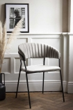 Lifestyle image of the Curved Back Velvet Dining Chair In Mink Grey