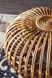 Angled detail image from above of the Handmade Woven Wicker Pouffe on mandala rug and wooden flooring