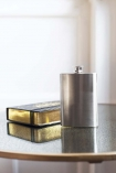 Image of the Flask and Good Book sat on a table