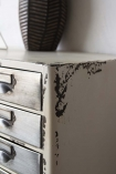 Close-up image of the distressed style Industrial-Style Filing Drawer Storage Cabinet distressed paint on top corner