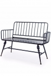 Industrial-Style Black Metal Two-Seater Bench on a white background angled cutout image