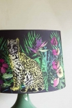 Detail Image of leopard and flowers on Matthew Williamson Midnight Jungle Table Shade on pale wall background
