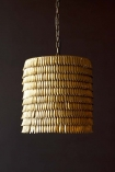 detail Image of the Metallic Feather Effect Pendant Light on its own on dark wall background