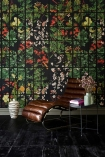 Lifestyle image of Japanese Garden wallpaper in anthracite  with chair and side table in front of it