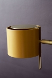 Close-up detail image of the shade on the Modern Gold Accent Table Lamp - Ochre Gold on dark wall background