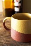 Close-up lifestyle image of the Two-Tone Ochre & Terracotta Mug