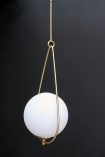 detail image of side of Globe Pearl Drop Ceiling Light with dark wall background
