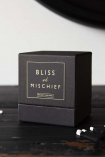 detail image of box of Rockett St George Scented Candles - Bliss And Mischief on black wooden table with cotton buds