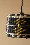 Close-up detail image of the Black, Natural & Yellow Rope Lamp Shade with cloisters painted wall background