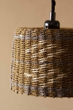 Close-up detail image of the Brown, Natural & Grey Rope Lamp Shade on cloisters painted wall background