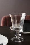 Lifestyle image of the Ribbed Glass Wine Glass