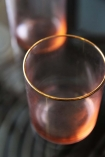detail image of rim on Set Of 4 Rose Pink & Gold Water Glasses on glass table