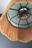 Close-up shot looking up the inside of the Bespoke Spearmint Silk Tiffany Lamp Shade with wavy fringe