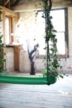 detail image of Swing With The Plants - Green with rustic brick walls in background