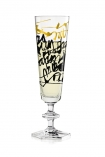 cutout image of lifestyle image of Ritzenhoff Champagne Flute - Nerodiseppia with black and gold messy writing on and box in background on black table with champagne in on white background