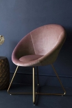 Side-angle lifestyle image of The Grand Velvet Circular Dining Chair in Rose Pink