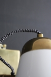 Close-up detail image of the top of the white The Mortimore Wall Light on dark wall background