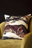 Lifestyle image of the Sleeping Tiger Velvet Cushion on ochre gold velvet chair with dark wall background