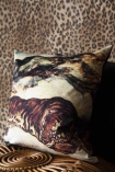 Lifestyle image of the Sleeping Tiger Velvet Cushion with the Rockett St George Leopard Love wallpaper in the background