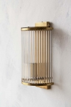 Lifestyle image of the Traditional Brass & Glass Tube Pillar Wall Light on white wall background