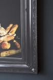 Close-up detail image of printed frame of Unframed White Roses Printed Canvas black on dark grey wall