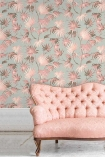 Lifestyle image of the Va Va Frome Blush Eau De Nil Wallpaper by Pearl Lowe with pink cushioned sofa and white flooring