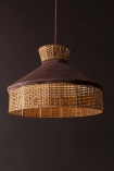 Lifestyle image of the Burgundy Velvet & Rattan Pendant Ceiling Light on a dark wall background