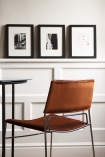 Lifestyle image of the back of the Chrome & Velvet Stackable Dining Chair In Rich Rust