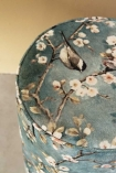 Close-up image of the top of the Blue Velvet Cherry Blossom Pouffe Foot Stool