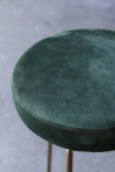 Close-up image of the seat on the Atlantis Velvet Bar Stool in Rich Green