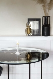 Close-up lifestyle image of the Vintaged Glass Mirror & Iron Round Dining Table