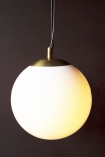 Close-up image of the Atlas Globe Pendant Light switched on