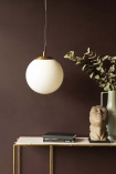 Lifestyle image of the Atlas Globe Pendant Light switched off