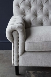 Close-up image of the arm on the Soft Grey Modern Chesterfield 3 Seater Sofa