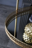 detail image of base of Antique Style Gold Metal Drinks Trolley on wooden flooring