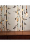square detail image of Smink Things Bamboo Trees Wallpaper behind wooden table