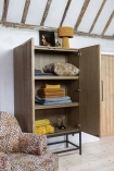Lifestyle of the Timber Strips Shelved Storage Cabinet with both doors open