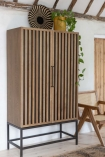 Lifestyle image of the Timber Strips Shelved Storage Cabinet