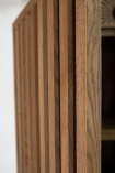 Close-up image of the detail on the Timber Strips Shelved Storage Cabinet