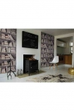 landscape lifestyle image of Young & Battaglia Bookshelf Wallpaper - Vintage on either side of dark fireplace and cowhide on floor