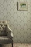 lifestyle image of Barneby Gates Boxing Hares Wallpaper - Stone - SAMPLE with armchair and picture hanging on wall