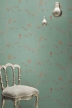 lifestyle image of Barneby Gates English Robin Wallpaper - Jade - SAMPLE with white chair and two silver bulb ceiling lights