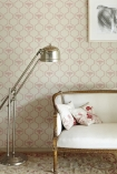 detail image of Barneby Gates Honey Bees Wallpaper - Rose On Stone - SAMPLE with cream and gold sofa and silver floor lamp with picture hanging on wall