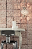 lifestyle image of NLXL TIN-06 Brooklyn Tin Tiles Wallpaper By Merci - SAMPLE with white desk and metal desk chair and lit up ceiling light