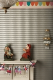 lifestyle image of Cole & Son Whimsical Collection - Titania Wallpaper - Grey 103/14057 - SAMPLE with white table and punch and judy statutrs on top and gold and glass wall light and ceiling light