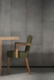 lifestyle image of NLXL CON-01 Concrete Wallpaper by Piet Boon - SAMPLE with green and wood chair at wooden table