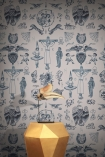 lifestyle image of Feathr Tattoo Flash 01 Wallpaper - Original - SAMPLE with gold side table and bird skull ornament