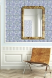lifestyle image of Louise Body Old Blue Tile Wallpaper - SAMPLE with brown chair and wall mirror
